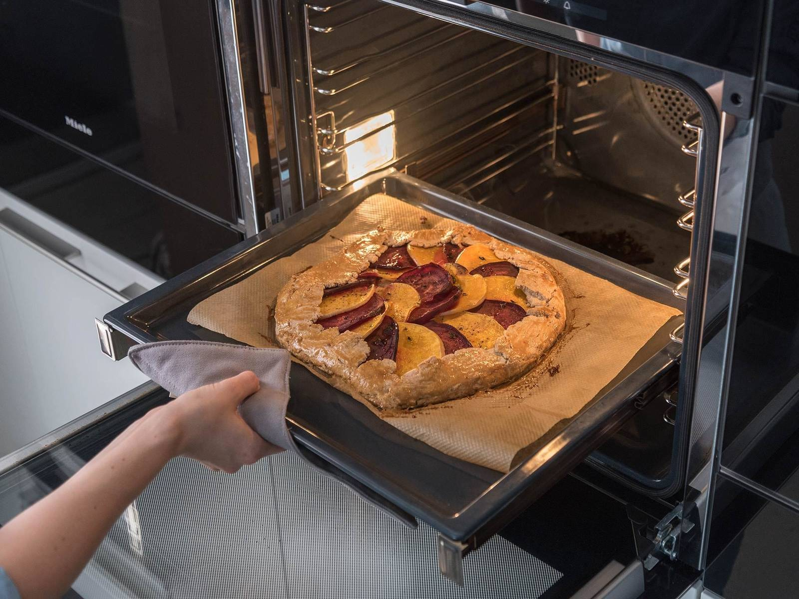 Brush dough with milk. Transfer galette to oven at 180°C/350°F for approx. 40 min., or until the dough is golden brown and the vegetables are cooked through. Remove from oven, let cool slightly,  then serve warm. Enjoy!