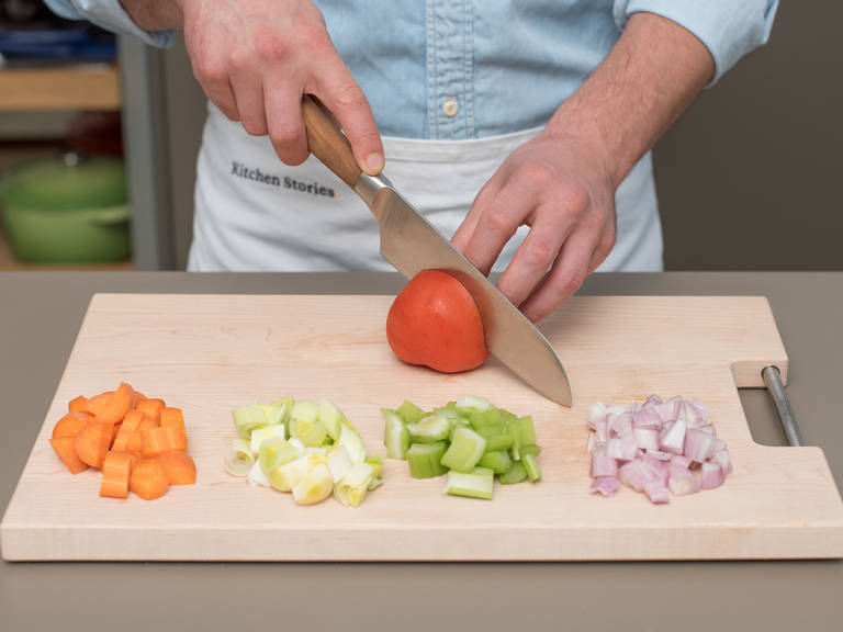 Preheat oven to 180°C/300°F. Roughly chop leek and celery. Peel and cut carrot and shallots. Quarter tomato. Set aside.