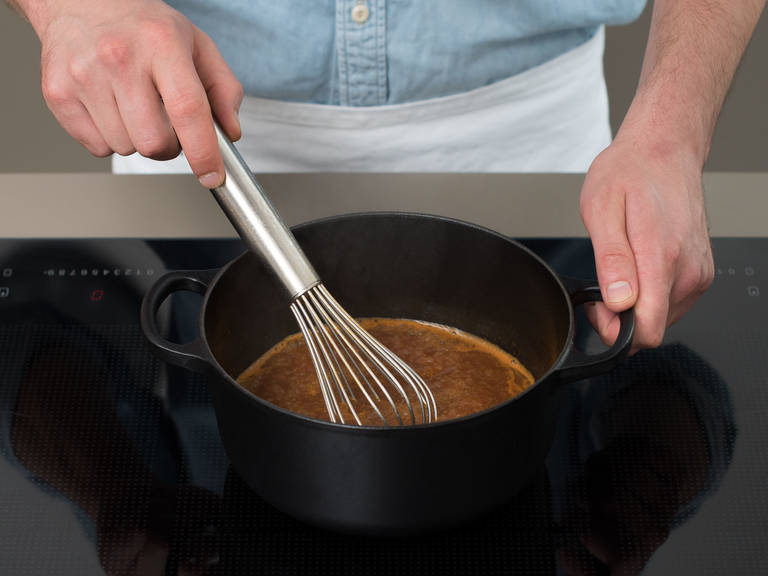 Once the roast beef is done, remove from oven. Take meat out of the pot and cover with aluminum foil. Let rest for approx. 10 min. Strain roast beef drippings into a small saucepan and bring to boil. Mix starch and water to make a slurry, then add to saucepan. Season with salt and pepper and let simmer until thickened. Slice roast beef and serve with mashed potatoes, red cabbage, and sauce. Garnish with parsley and enjoy!