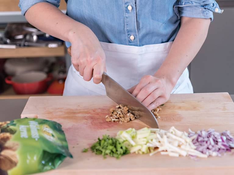 Peel apples and celery and julienne. Finely chop walnuts, parsley, and red onion.
