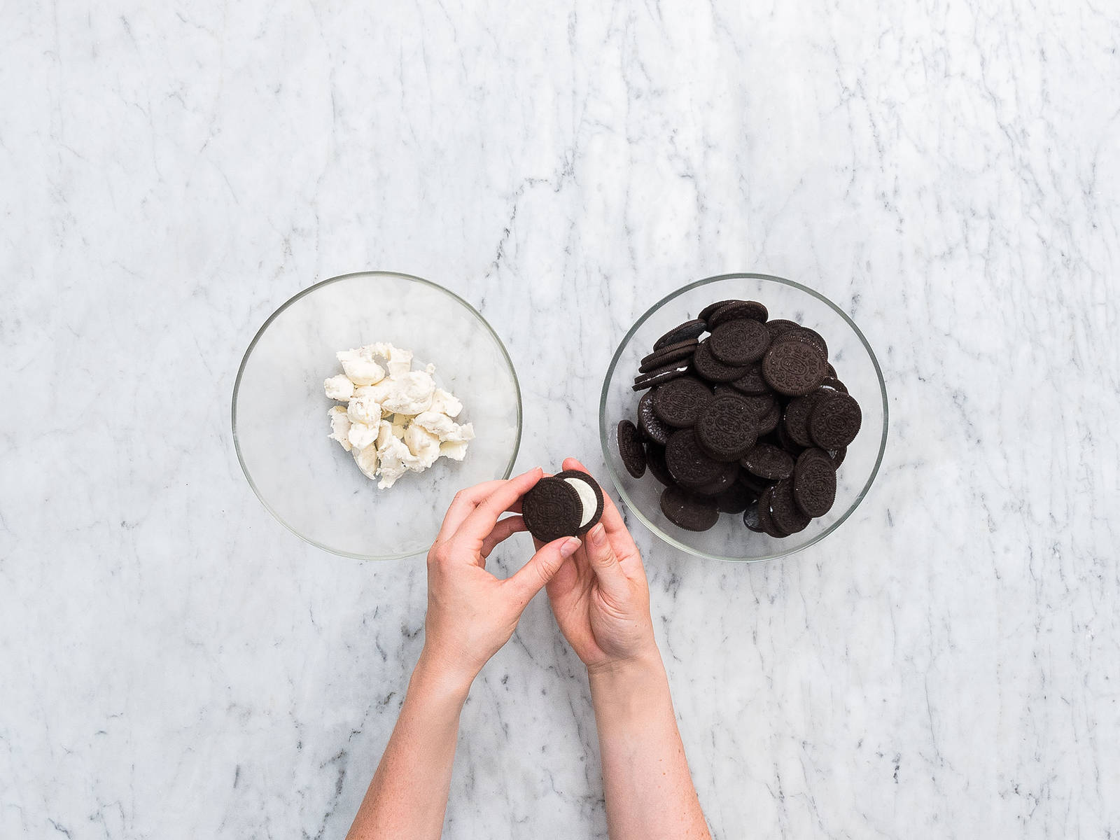 Split open Oreos, dividing the cookies into one bowl and the frosting into another. Set aside ten cookies for garnish. Mix together the Oreo frosting and the cream cheese. Halve the mixture and combine one half with raspberry jam.