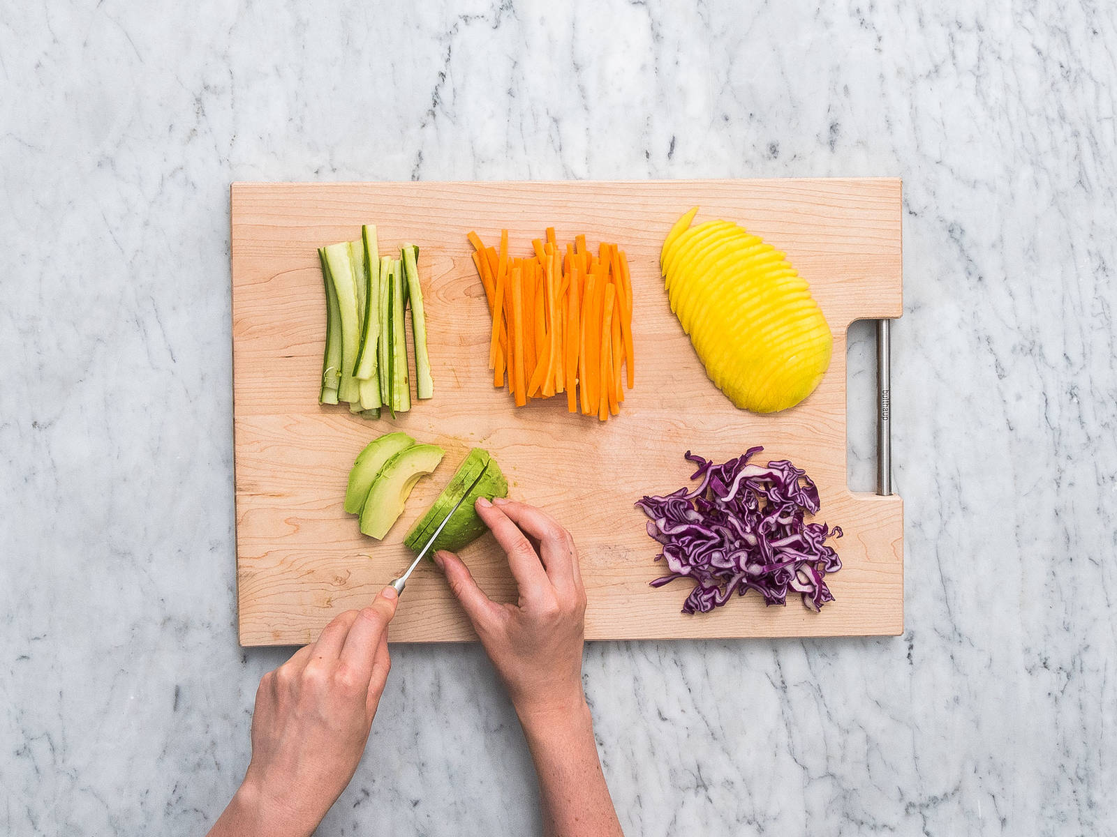 Peel and slice the carrots, and chop the cucumber and red cabbage into fine matchsticks. Finely slice mango, radish and avocado. Cut the cress.