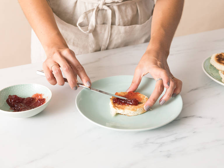 Using the same cookie cutter, cut four equal rounds from the brioche. Save the extra to eat or for another dish. When the ice cream rounds are solid, heat a frying pan and toast the brioche rounds until golden brown. Transfer to a plate, spread strawberry jam onto half of the brioche rounds, top with the ice cream rounds, and cover with remaining brioche slices. Serve the ice cream sandwich news immediately and enjoy!