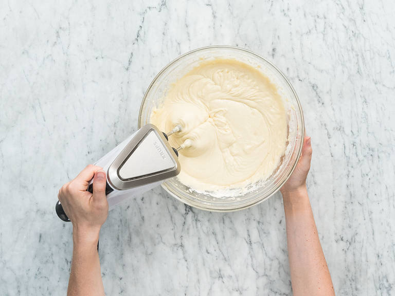 Preheat oven to 180°C/355°F. Add eggs, softened butter, sugar, vanilla sugar, and salt to large bowl and beat until creamy. Mix flour and baking powder in a second bowl, then add to butter mixture along with buttermilk and stir to combine.