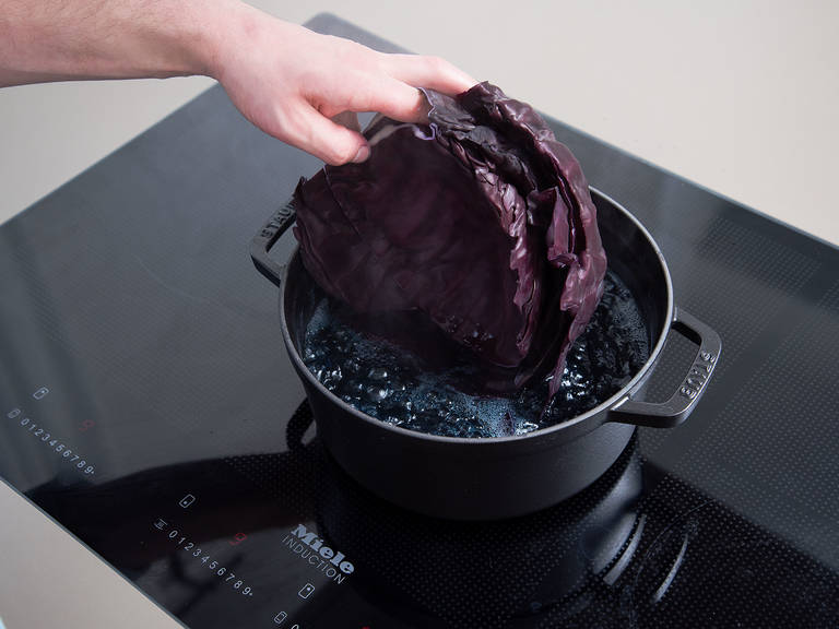 Preheat oven to 170°C/340°F. Remove outer leaves and stem from a red cabbage and discard, then carefully remove some inner leaves. Blanch in salted boiling water, then transfer directly to an ice bath. Set aside.