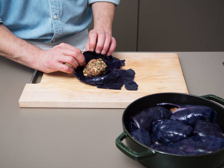 Spoon 1 – 2 tbsp of filling onto the center of each red cabbage leaf. Fold the sides in, then roll the bottom over to seal.