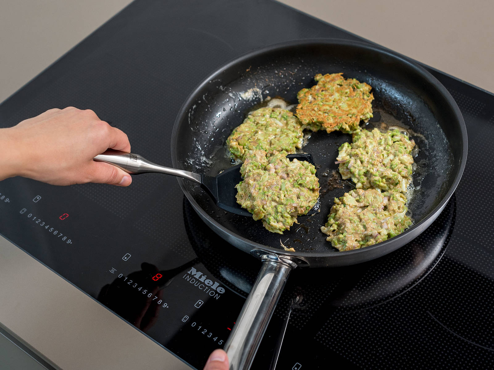 Heat oil in a frying pan set over medium-high heat, add a spoonful dough, and press gently to flatten slightly into pancakes. Fry the pancakes on both sides until golden brown, then transfer to a paper towel-lined plate to drain slightly. Serve with herb dip and a squeeze of lemon juice to taste. Enjoy!