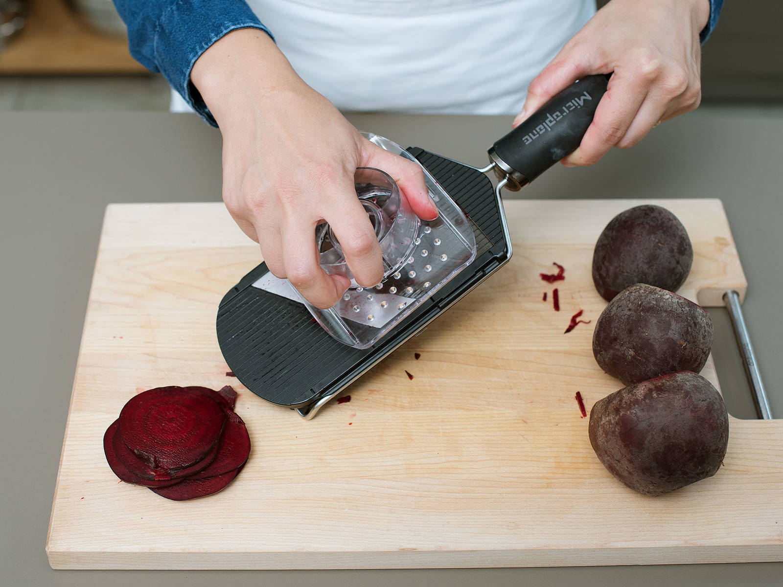 Wash beets, pat dry, and cut off the ends. Slice very thinly with a mandolin.