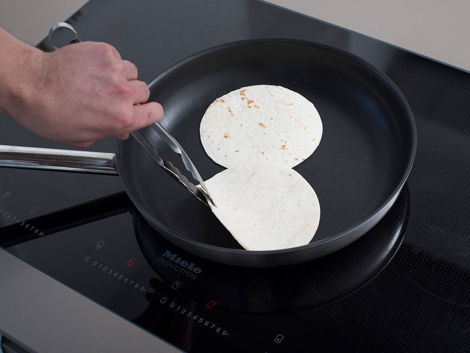Heat a dry frying pan over medium heat and toast each tortilla on both sides for approx. 20 – 30 sec.