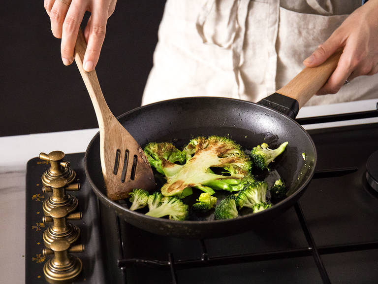Heat the same frying pan used to toast the hazelnuts over medium-high heat, add olive oil, and lay in the sliced broccoli cut-side down. Cook on each side for about 1 - 2 min. or until browned.