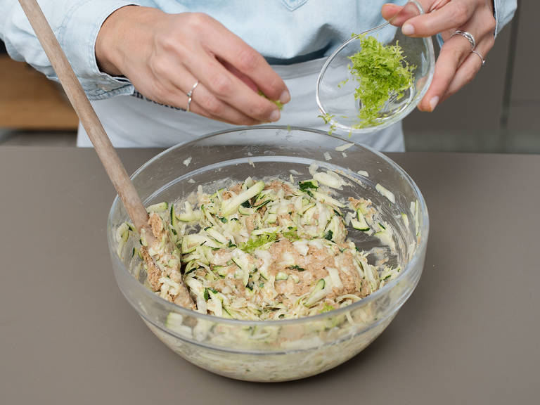 For the dough, beat coconut, cane sugar, and eggs in a bowl until frothy. Then add the flour and baking powder and stir to combine. Fold grated zucchini and lime zest into the batter.