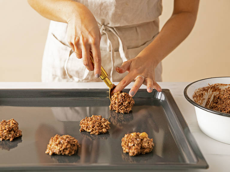 Make tablespoon sized rounds using an ice cream scoop and place transfer to a baking sheet. Flatten into cookies and bake at 170°C/350°F for approx. 12 – 15 min. Enjoy!