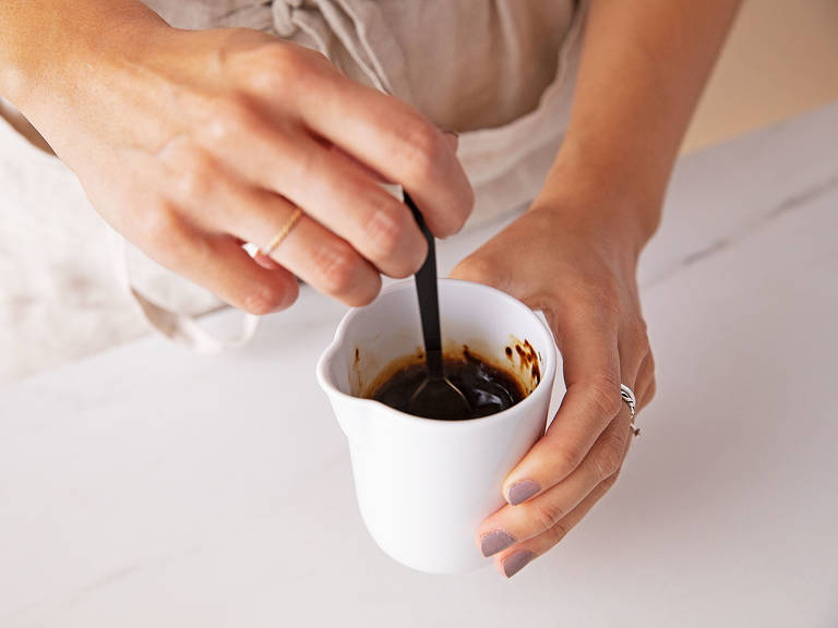 Mix the instant espresso powder with equal parts boiling water, stir to combine, and set aside to cool.
