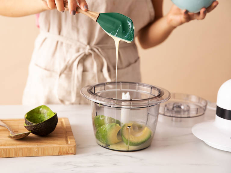 Blend avocado and sweetened condensed milk in a food processor with a pinch of salt. Whip heavy cream to stiff peaks in a cold bowl using a hand mixer.