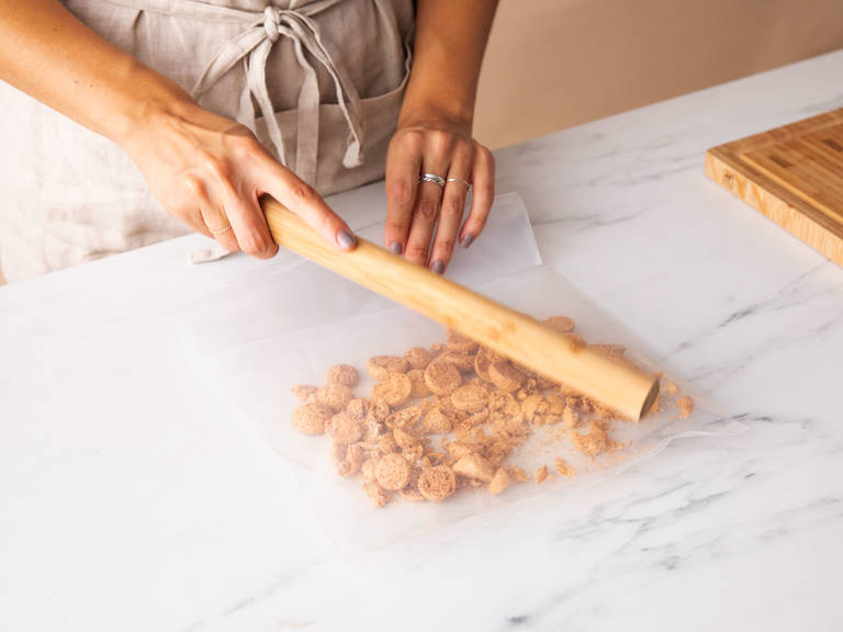 Beat the mascarpone in a bowl with a hand mixer until fluffy. Put amaretti cookies in a resealable freezer bag and bash to pieces with a rolling pin. The cookies pieces should still be chunky, with very little fine powder.
