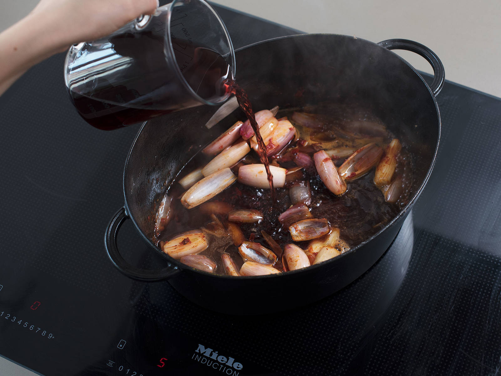 Add shallots, and sauté on medium-high heat for approx. 3 min., until translucent. Add tomato paste, and deglaze with red wine. Add meat back into pot and let simmer for approx. 10 min.