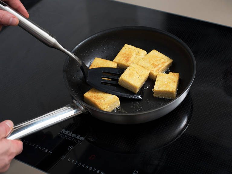 Remove polenta from the fridge. Cut off the edges, then cut polenta into 3x4-cm/ 1x1.5-in. pieces.