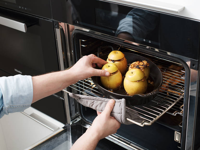 Remove goose legs and stuffed apples from the oven.