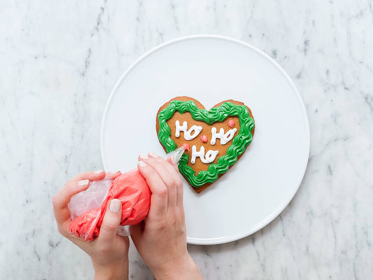 Transfer all three icings into separate piping bags with tips. Decorate gingerbread hearts as desired and enjoy for yourself or as a gift!