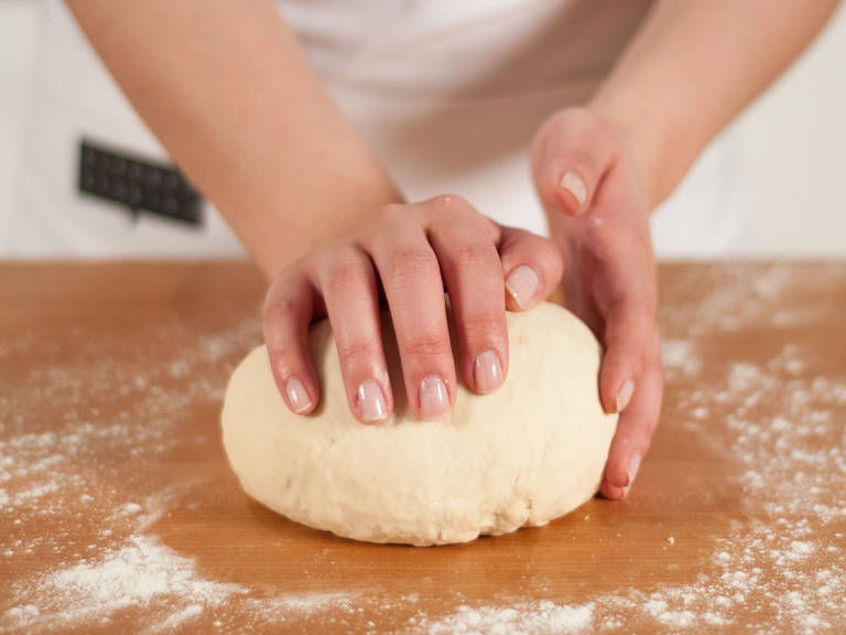 On a lightly floured surface, continue to knead dough by hand until smooth. Place into a bowl and cover with a clean kitchen towel. Set aside and allow to rest for approx. 30 – 40 min.