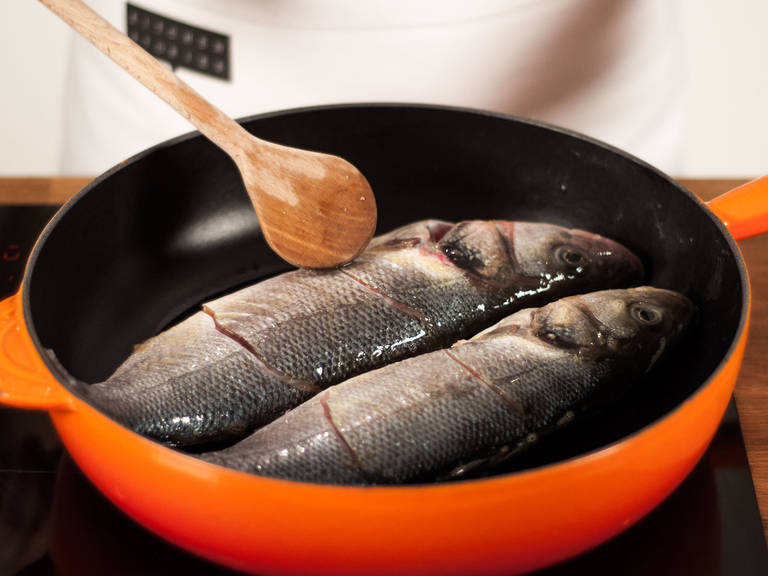 Preheat vegetable oil in a pan on medium-low heat. Place fish into pan and fry for approx. 1 min. on each side.