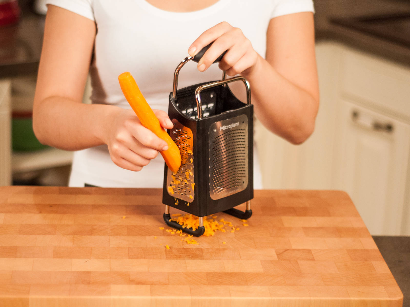 In the meantime, roughly grate carrot using a box grater.