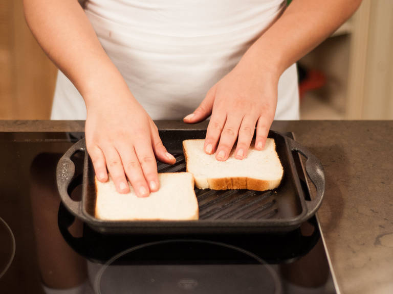 Toast bread slices on a grill pan over medium heat for approx. 1 – 2 min. per side.