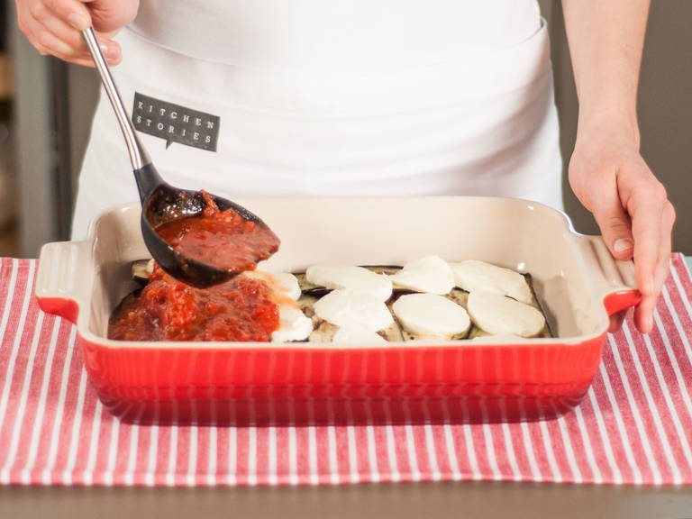 In a baking dish, create two separate layers of eggplant, mozzarella, and tomato sauce.