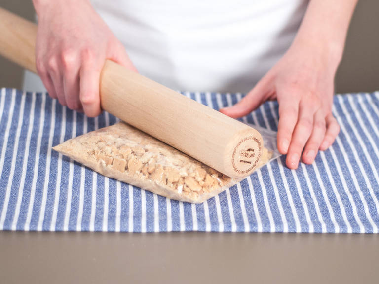 Place cookies into a freezer bag. Tightly seal and crush cookies with a rolling pin.