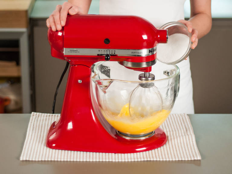 Preheat oven to 180°C/350°F. In a stand mixer, beat together eggs and half of sugar until frothy.