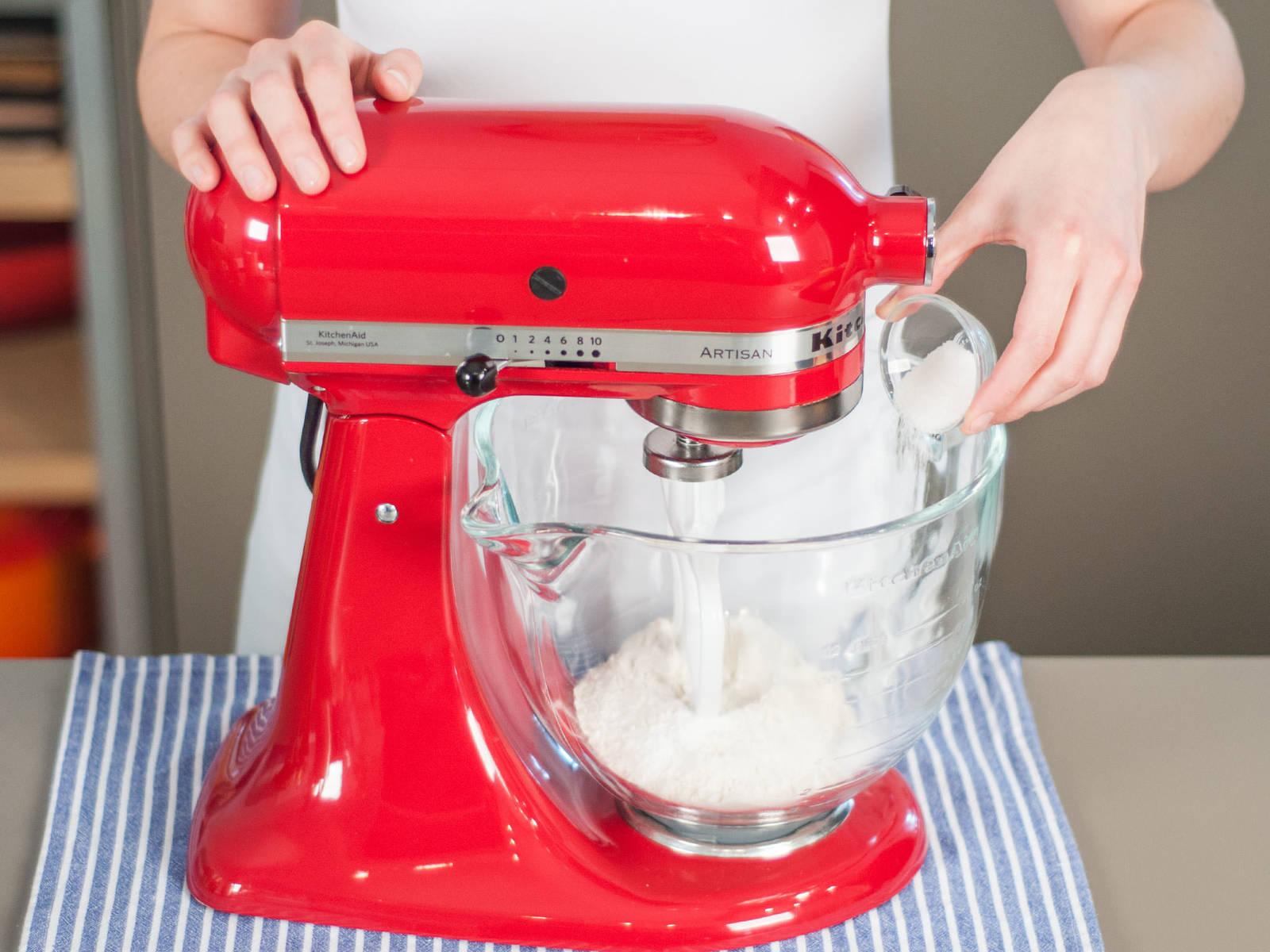 In a standing mixer, combine flour, baking powder, vanilla sugar, and a pinch of salt.