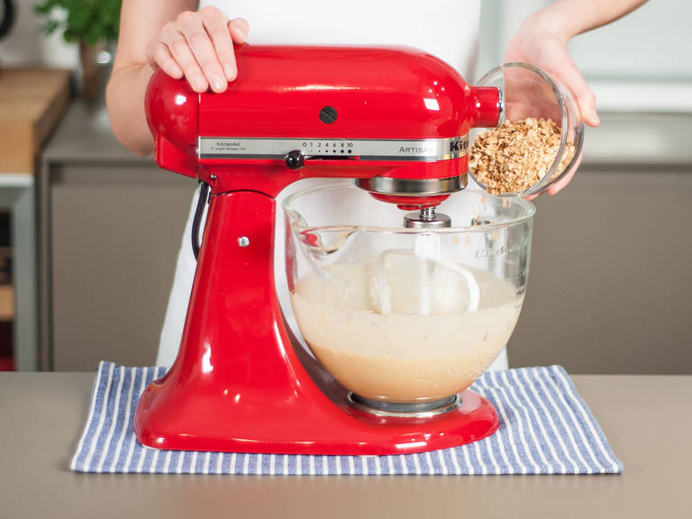 Add crushed hazelnuts to mixer and beat to combine.