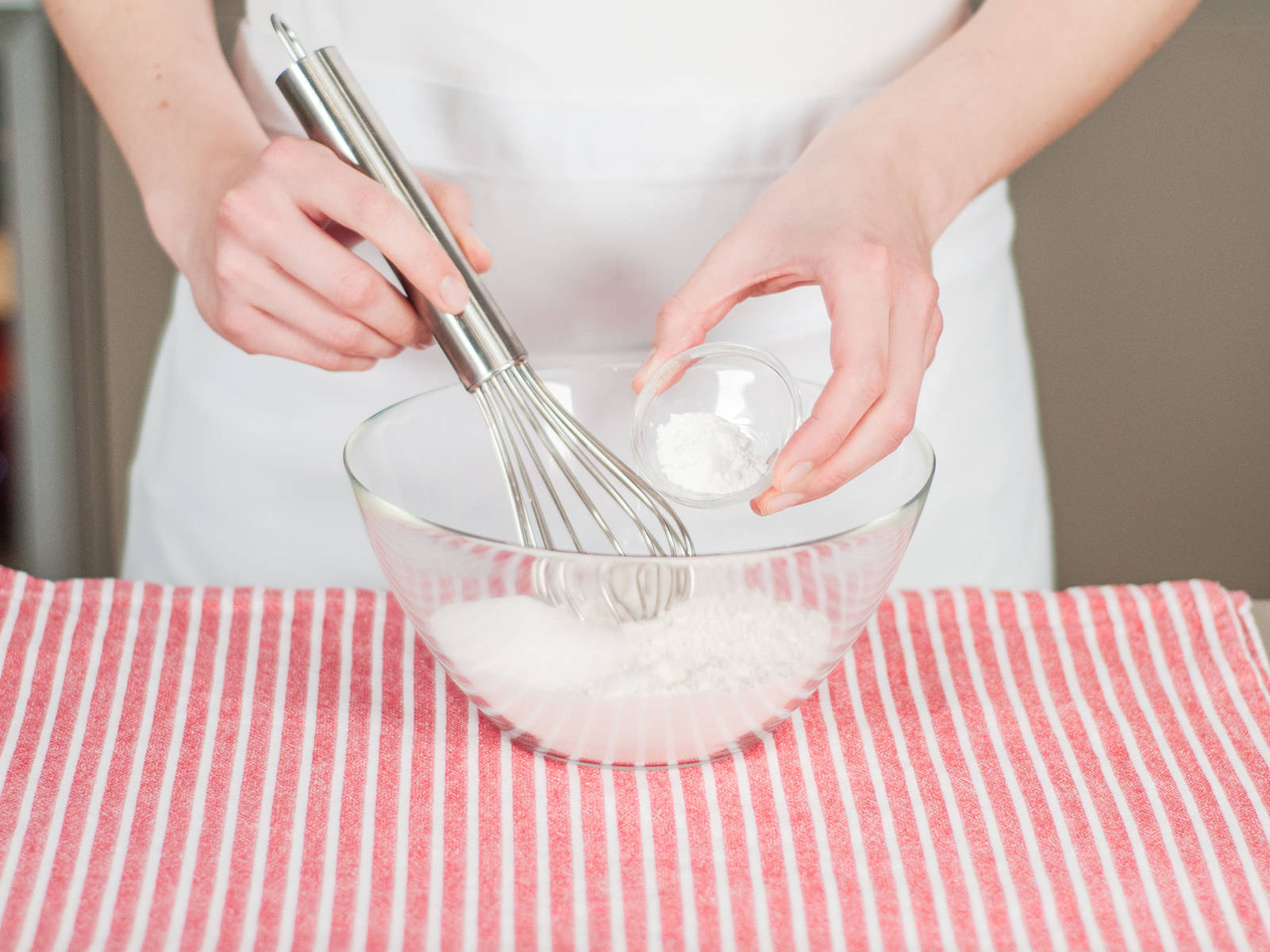 Whisk together flour, some of the sugar, a pinch of salt, and baking powder.