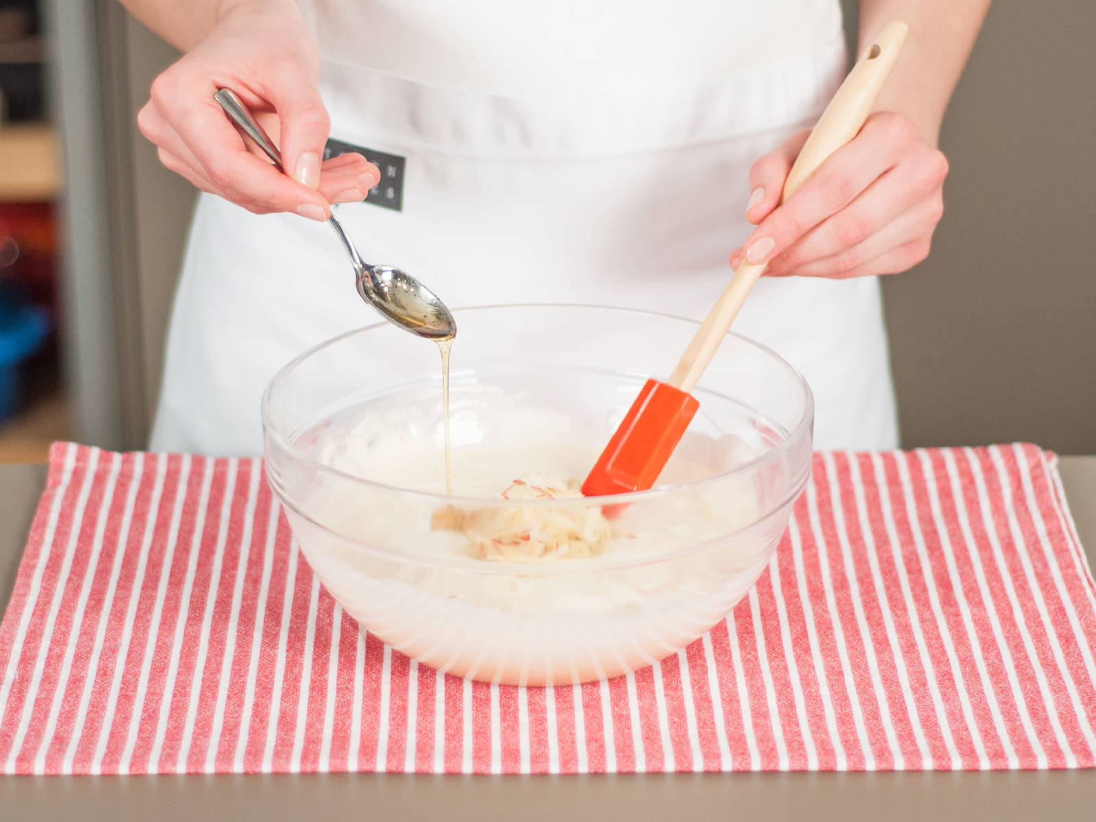 Grate apple into the batter and add vanilla extract. Stir to combine.