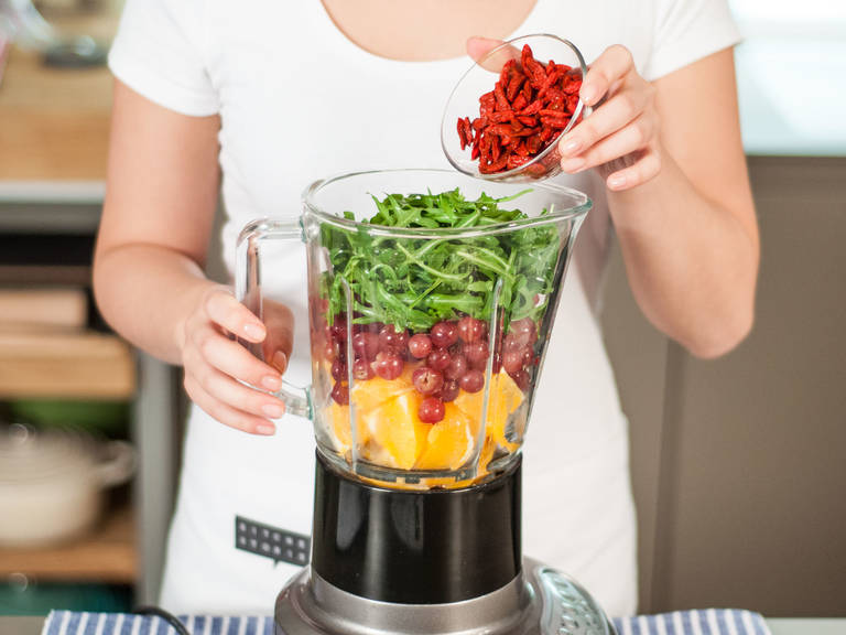 Add bananas, oranges, grapes, arugula, water, ice cubes, and berries to blender. Blend on high for approx. 1 - 2 min. until well mixed. Add some honey for more sweetness, if desired. Enjoy as a snack or for breakfast!