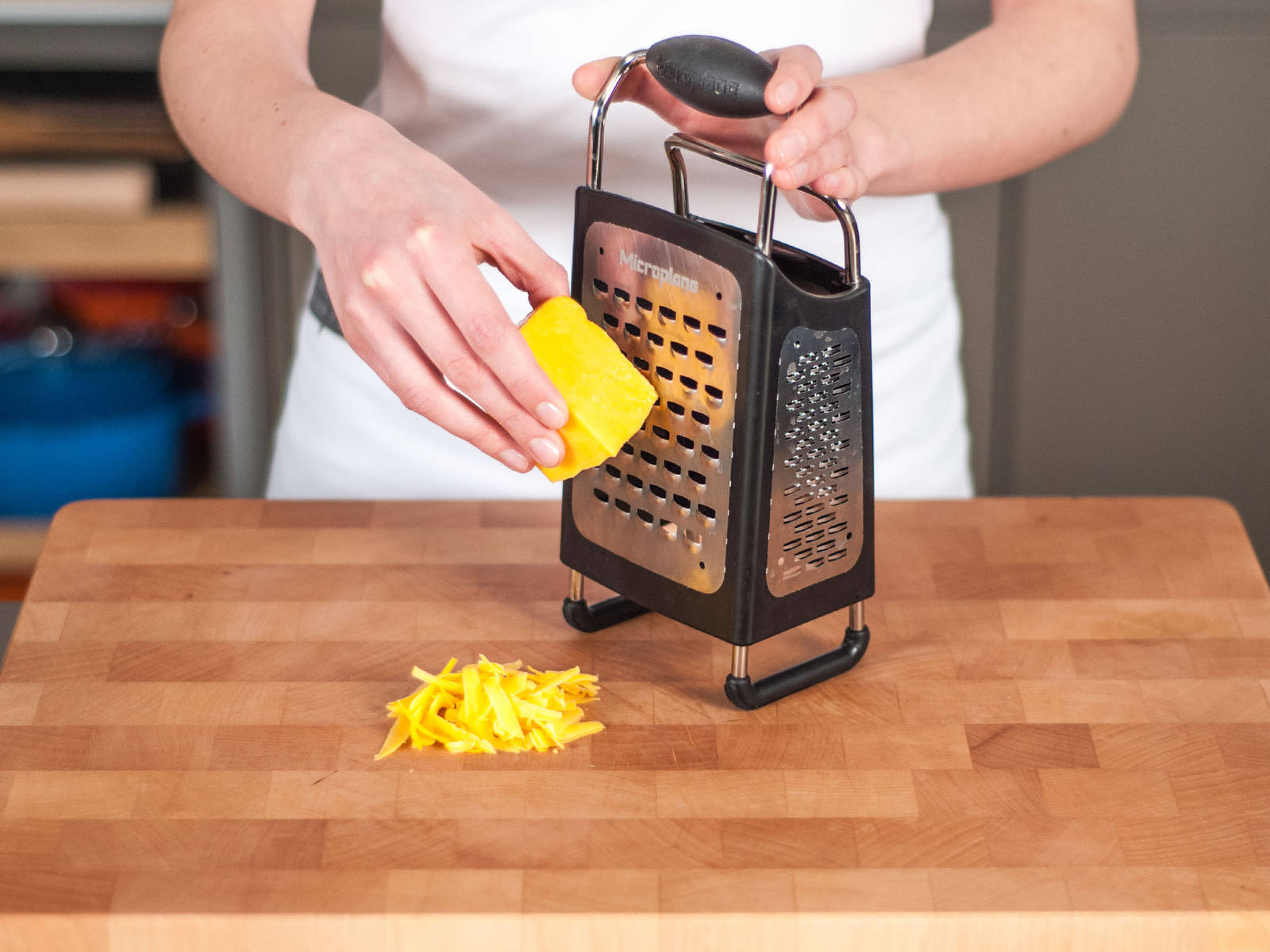 Grate cheddar cheese.
