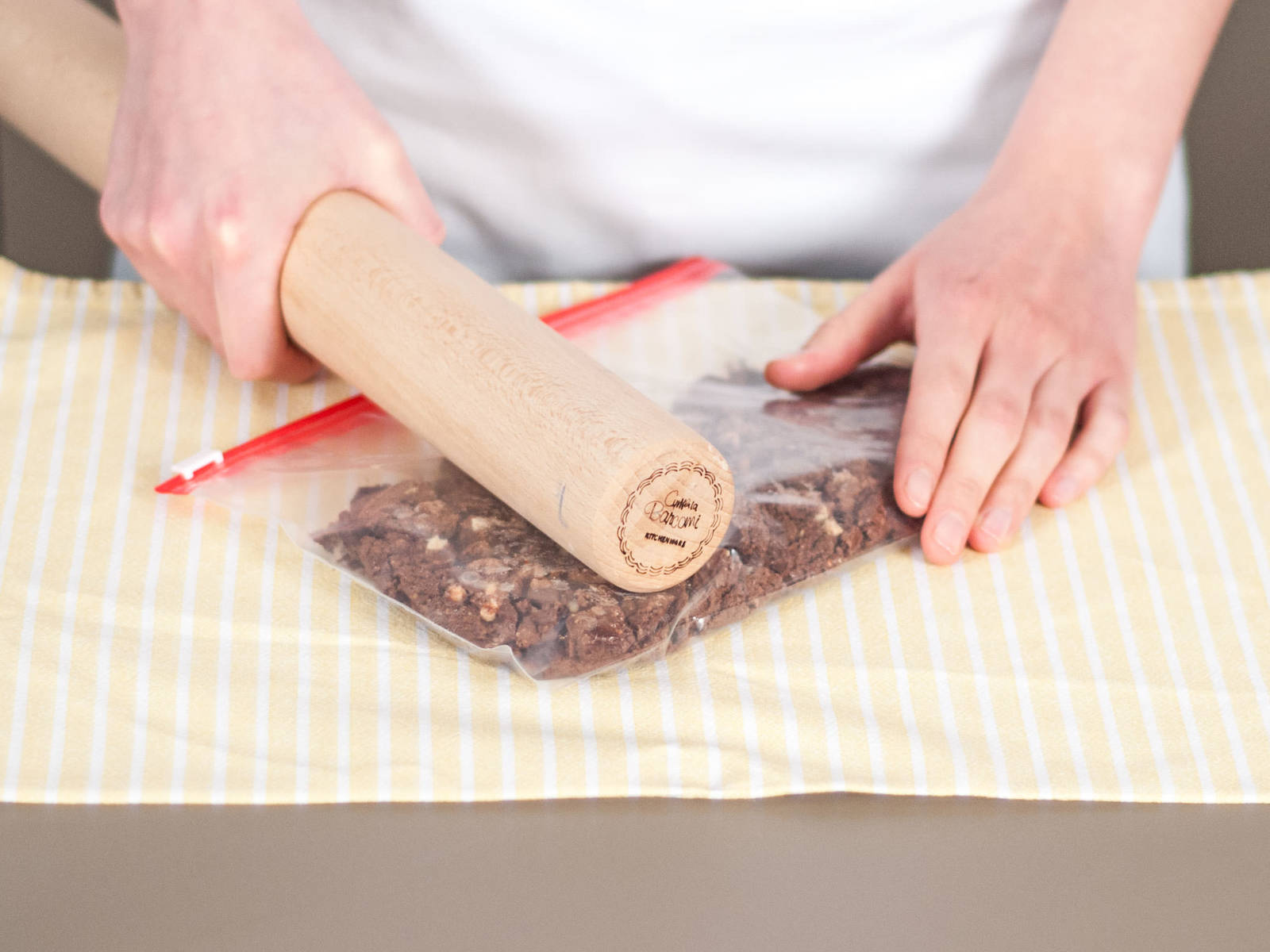 Place cookies into a freezer bag. Tightly seal bag and crush cookies with a rolling pin.