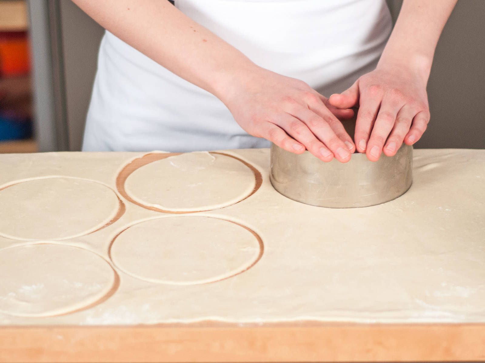 Preheat oven to 180°C/350°F. Lightly flour work surface. Roll dough into a thin layer with a rolling pin. Using a dough cutter, cut out rounds.