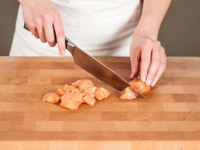 Cut chicken into bite-sized pieces.