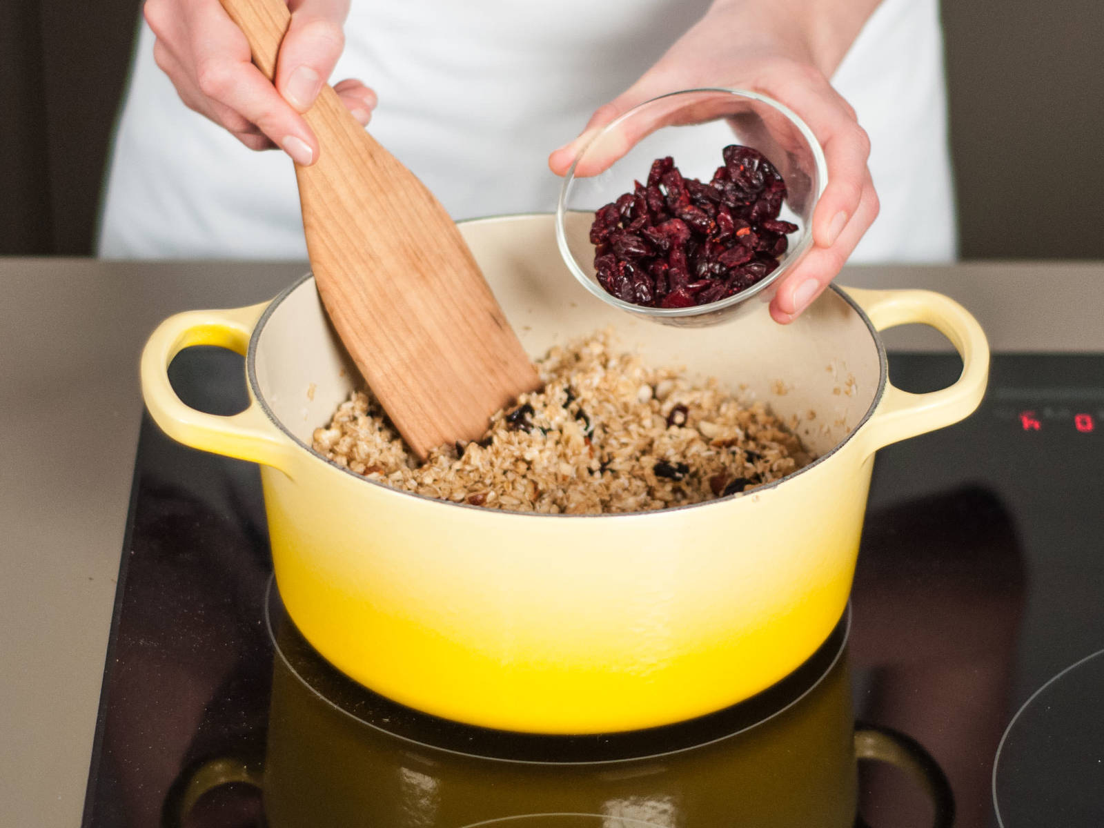Add oats, coconut, chopped nuts, dried fruit, and cranberries. Stir thoroughly to combine.