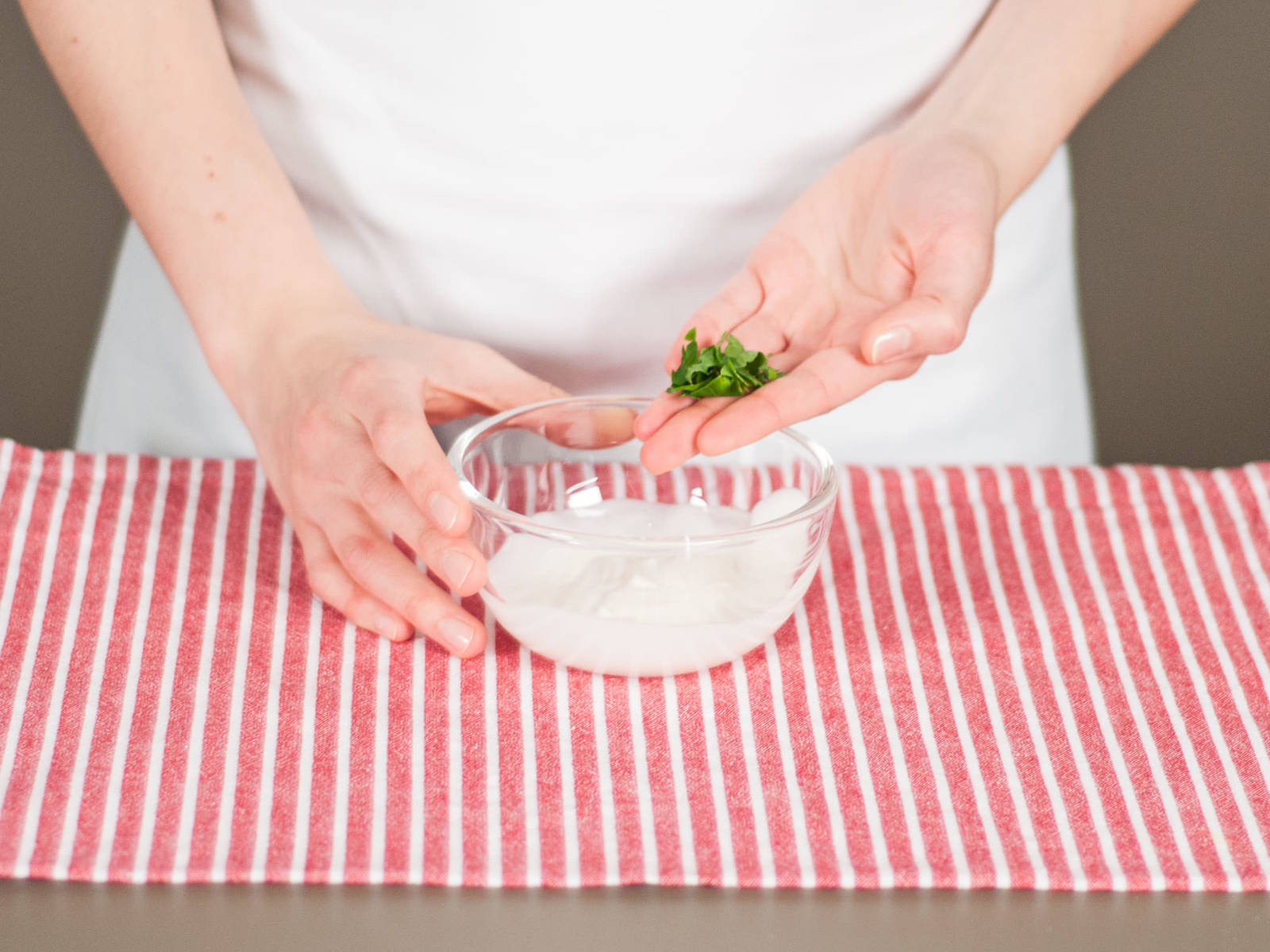 Finely chop parsley and chives. Mix herbs with yogurt and cream cheese. Season with salt and pepper to taste. Arrange items in your child's lunchbox or serve right away.