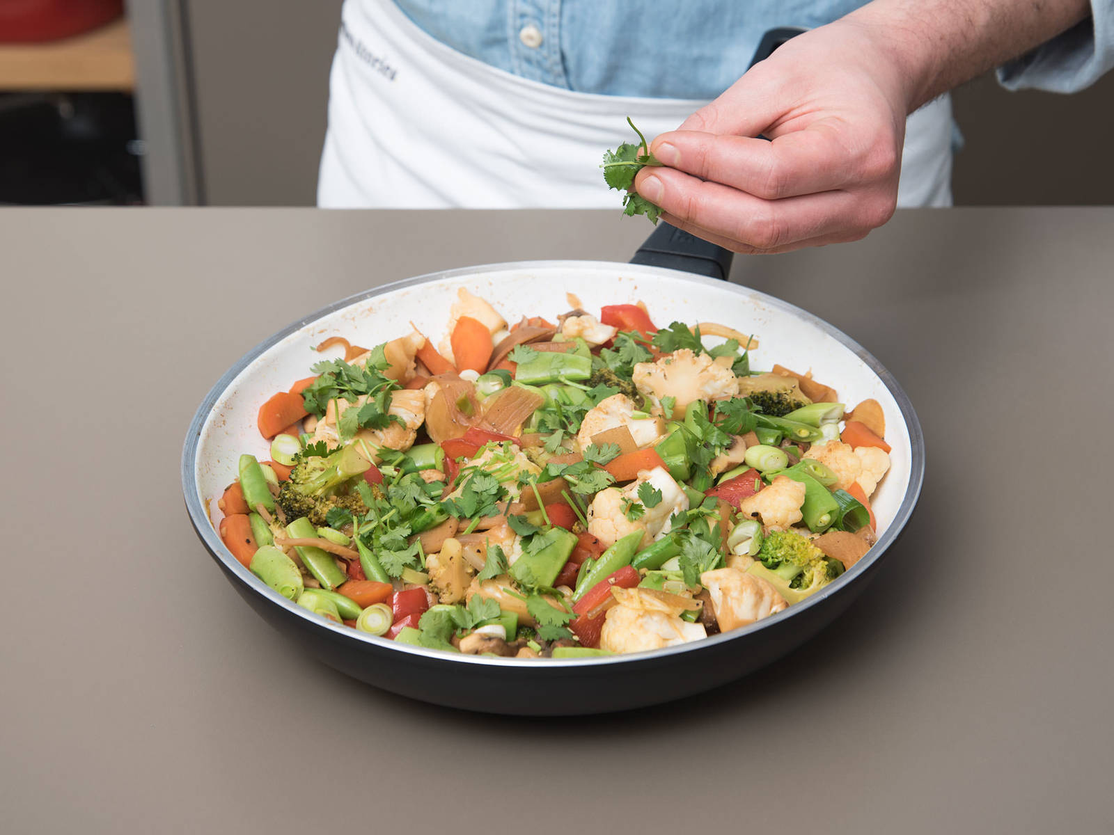 Add bamboo shoots and Chinese cabbage to the pan. Add ginger-lime sauce, stir to combine, and sauté for another 7 – 10 min. Add snow peas and season to taste with salt and pepper. Finally, stir in sliced green onion. Remove from heat. Garnish with cilantro and enjoy with rice!