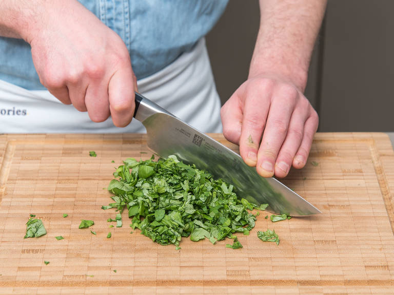 Chop basil. Dice butter and add to a food processor. Juice lemon and add salt, cayenne, pepper, and basil. Blend until everything is incorporated. Transfer to a piece of plastic wrap, form into a log, and wrap tightly. Refrigerate for at least 30 min.