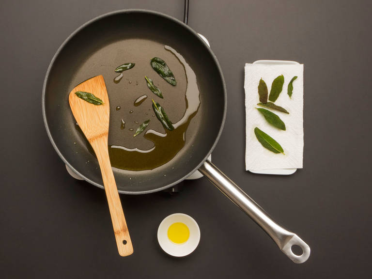 Heat up olive oil in a large frying pan over high heat. Add sage leaves to pan and cook for approx. 1 min. until crispy. Take care not to burn the leaves! Transfer to a paper towel-lined plate to dry. Keep oil in pan.