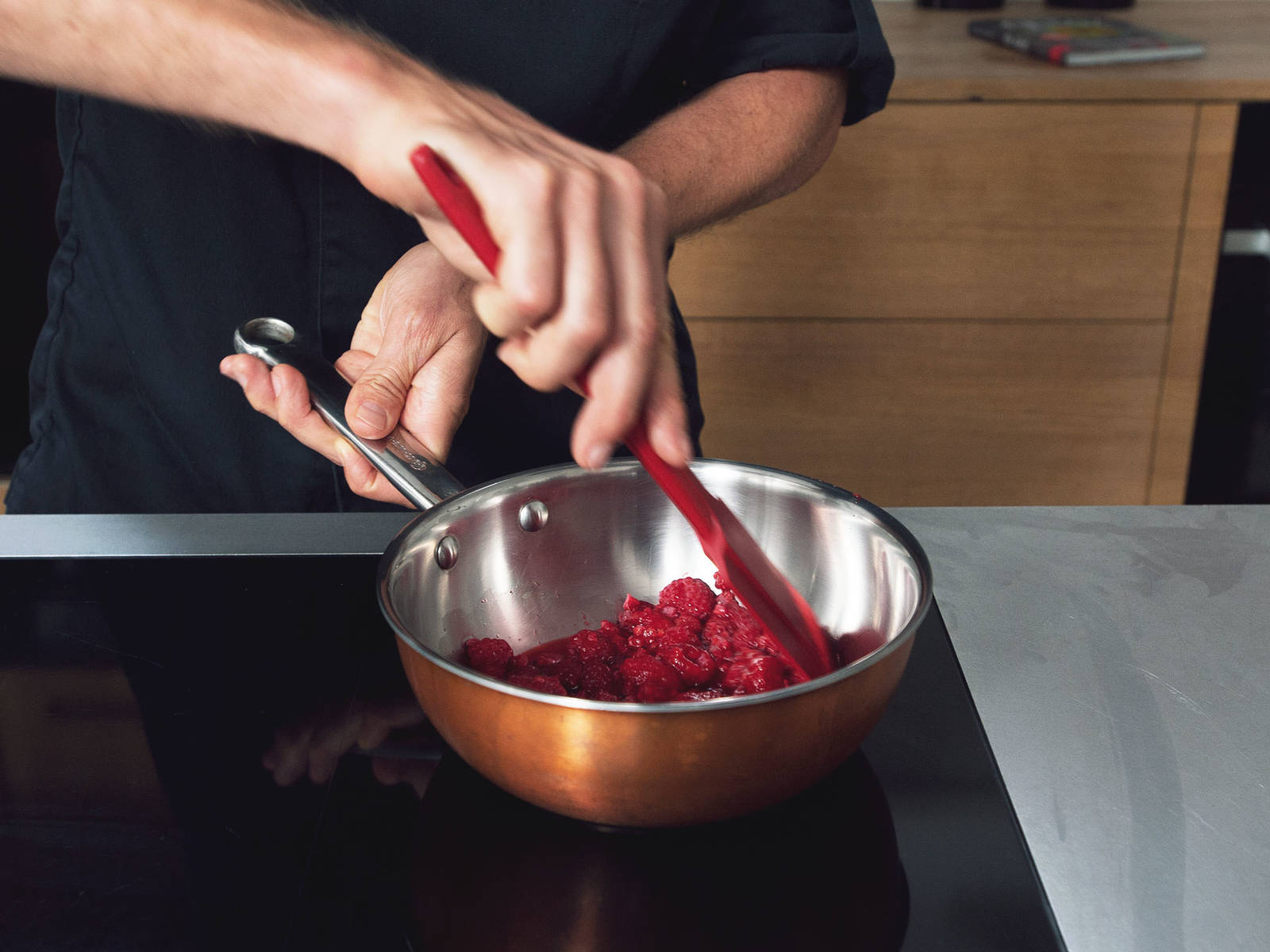 Add two-thirds of the raspberries to a small saucepan and bring to a boil over medium-high heat to defrost.