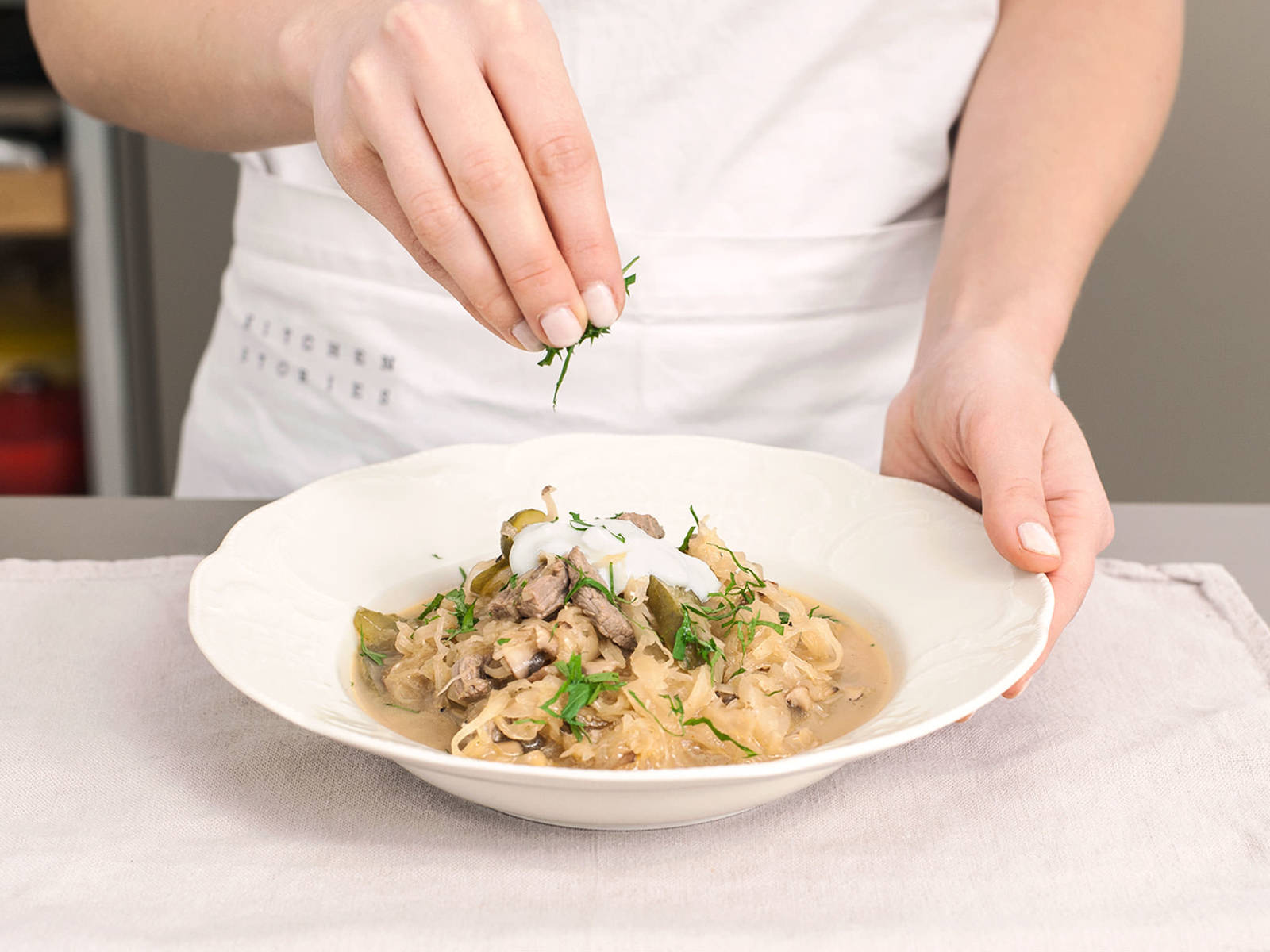 Transfer stew to two serving dishes and garnish with sour cream, parsley, and salt and pepper to taste.