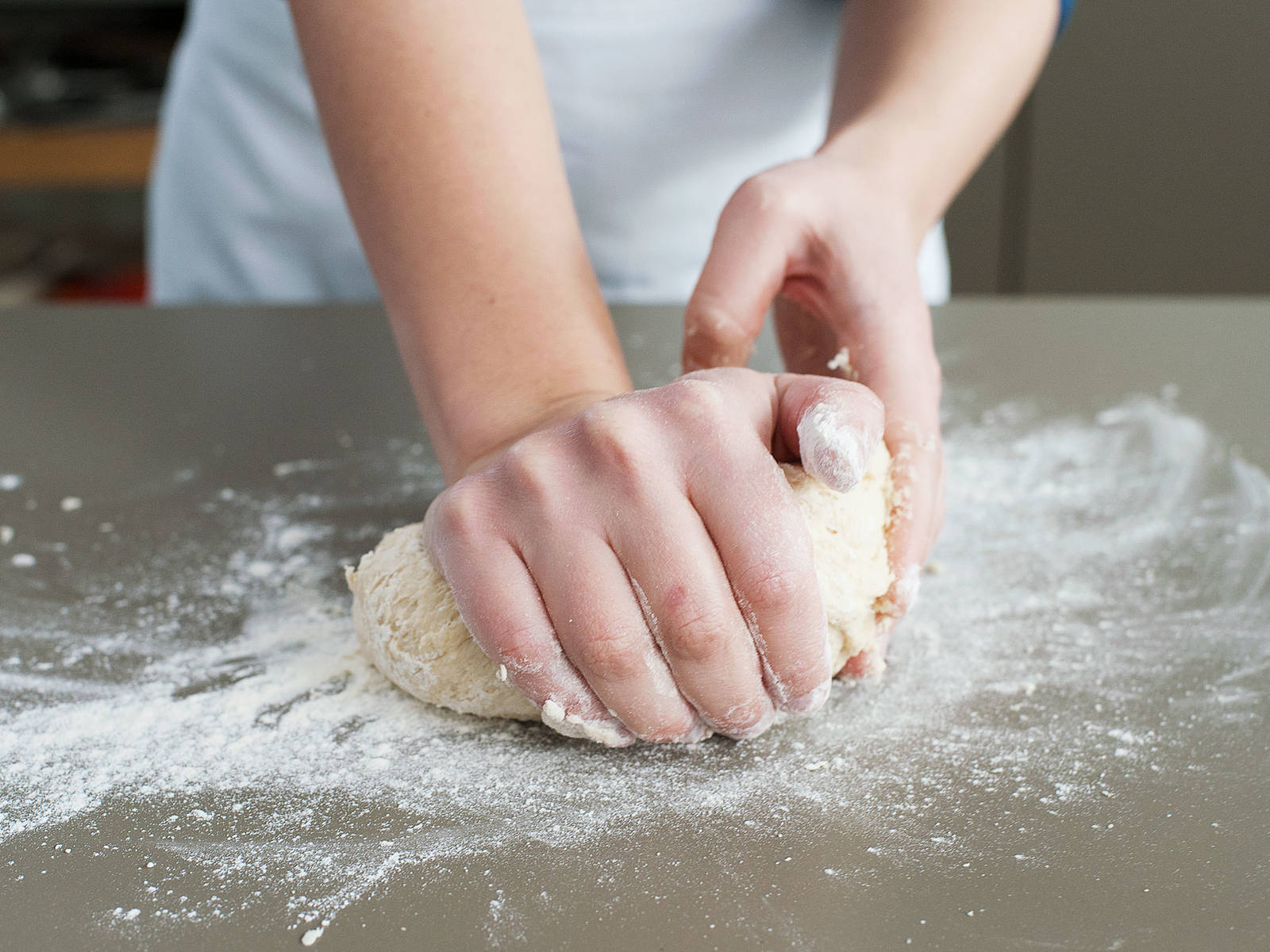 To prepare the buns, add flour, yeast, salt, and malt to a large mixing bowl. Stir to combine, then add some milk, water, sugar, soft butter, and half of the beaten egg. Combine with a rubber spatula. Then knead for approx. 6 min. with hands, until the dough springs back when you push it gently with your finger.