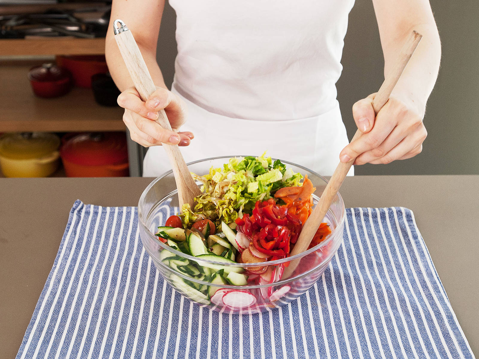 Pour dressing over the salad, a small amount at a time, and toss until well combined. Enjoy!