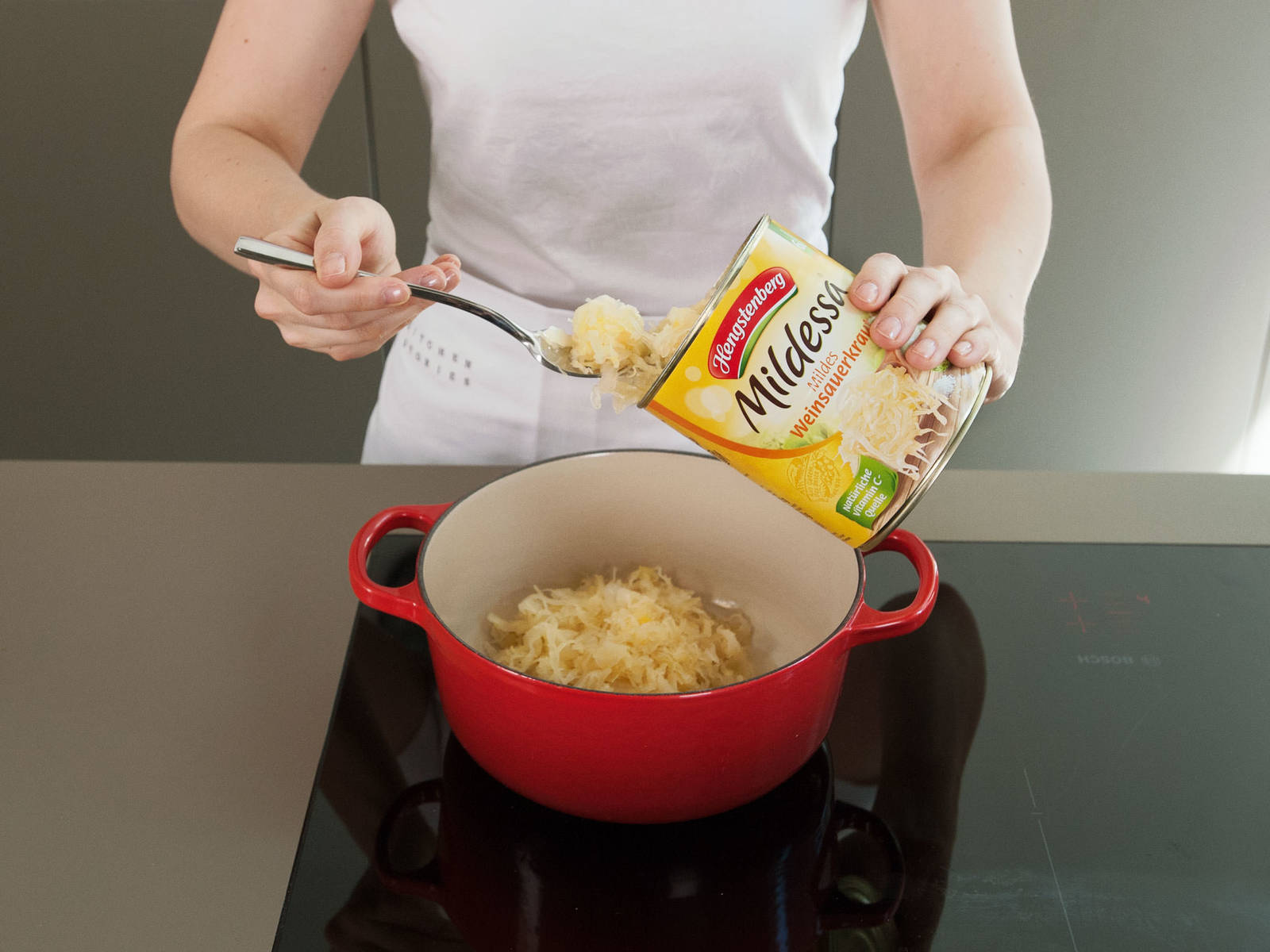 In a large saucepan, heat up sauerkraut over medium heat for approx. 4 – 5 min.