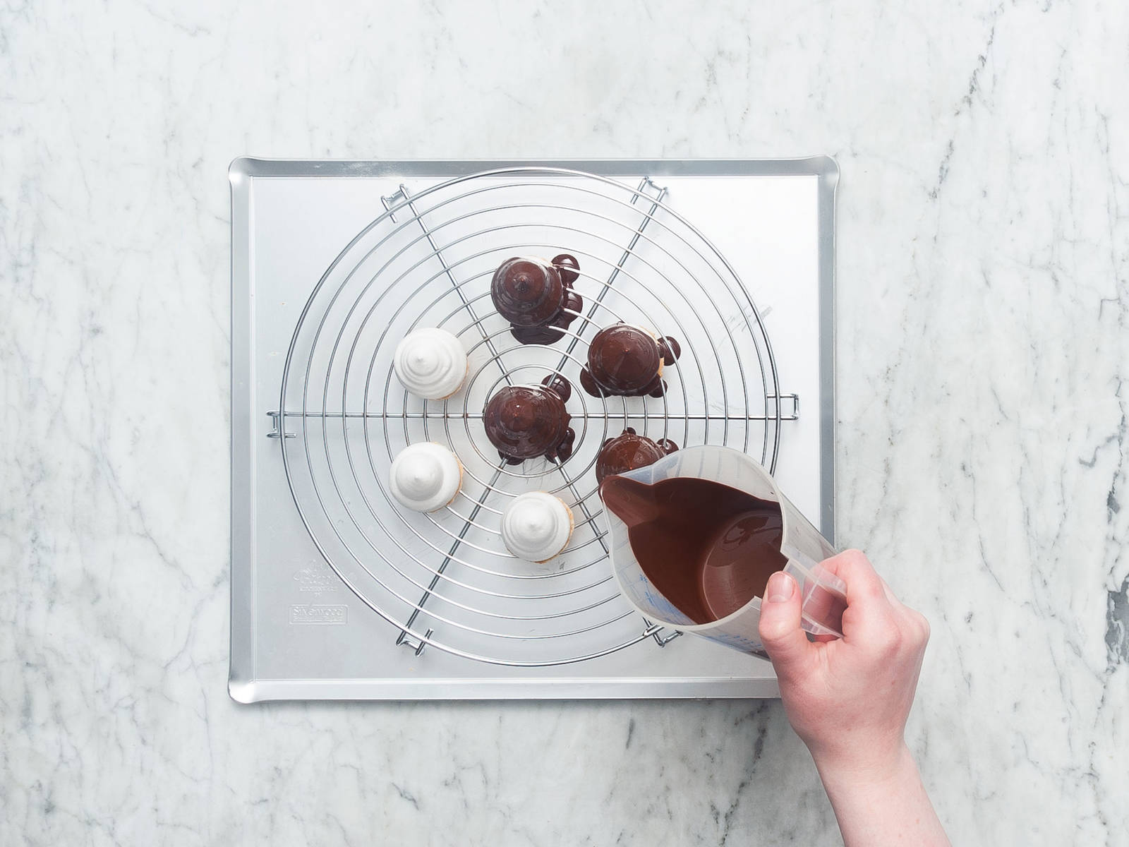 Pour chocolate over meringues carefully until they're evenly covered. Refrigerate mallomars for approx. 20 min. and enjoy cold!